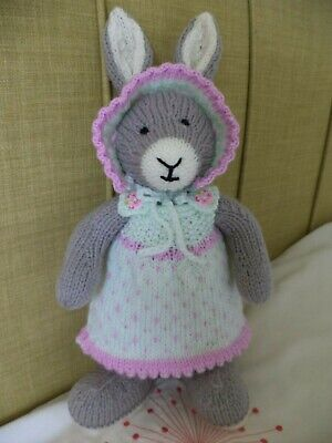Cute Girl Bunny Rabbit In  Mint And Lilac Dress And Bonnet