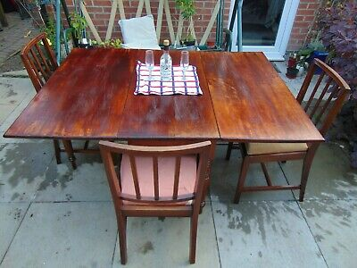 Large mahogany 18th century drop leaf dining table with three mahogany chairs