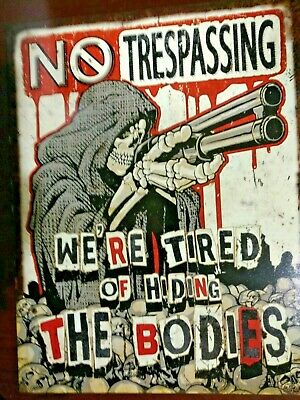 No Trespassing We're Tired Of Hiding The Bodies Tin Sign Skeleton With Gun