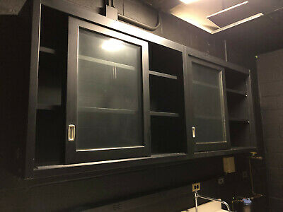 7' Stretch of Black Kewaunee Glass Overhead Cabinets