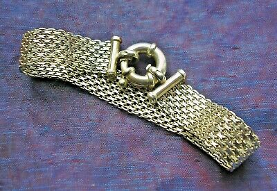 Beautiful Sterling Silver openwork bracelet with large round clasp