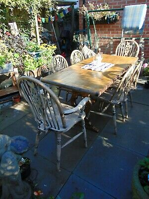 Ercol 1960's carved refectory dining table with six oak dining chairs