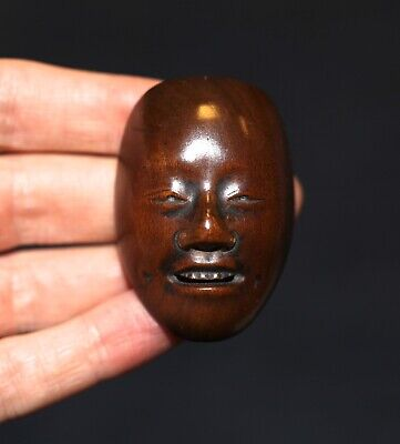 antique Japanese carved boxwood Netsuke of a Mask, signed Deme, 19th Century.