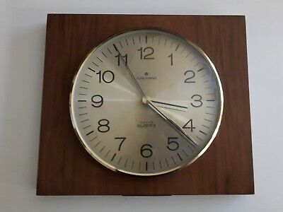 Vintage 1970's Junghans astral quartz  Wall Clock with Gold Face. Made Germany