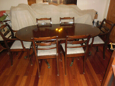 Antique style dinning room table and 6 chairs