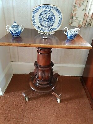 Antique Edwardian Pedestal Table With an Elegant Large Turned Base on Castors
