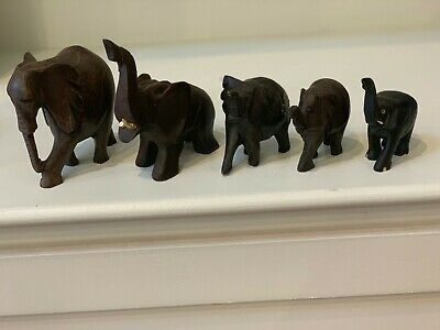 5 antique carved wood elephants, some broken tiny horns
