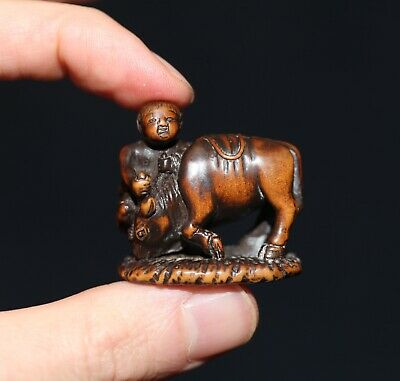 antique Japanese carved boxwood Netsuke of a Boy riding a Ox, 19th cent, Meiji.