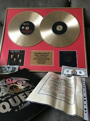 Queen memorabilia limited edition gold disc, queens greatest hits.