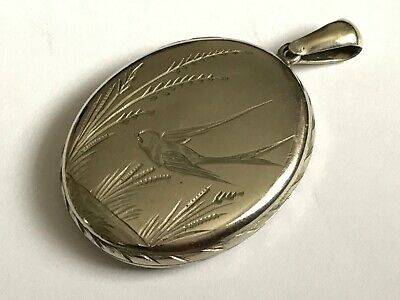 Antique Victorian 1890's silver plated swallow bird locket pendant.  1 5/8""