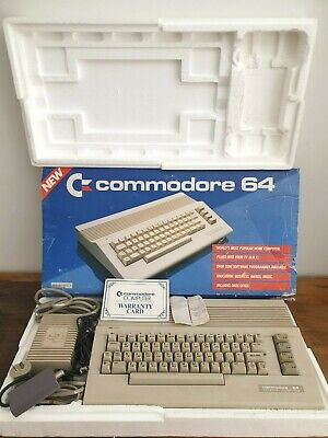 COMMODORE 64, with box,warranty card, Commodore Power Supply, Nintendo RF Switch