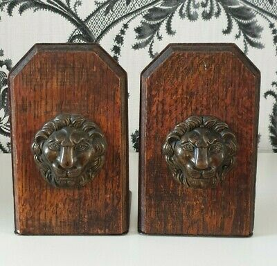 Nice old pair of lion bookends. Wood and brass