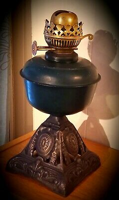 Victorian oil lamp with cast iron base.