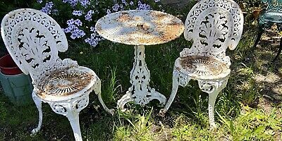Antique white CAST IRON garden setting table and chairs.  Very heavy and solid