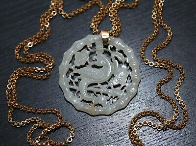 Antique Chinese carved jade parrot pendant strung with later chain, Qing Dynasty