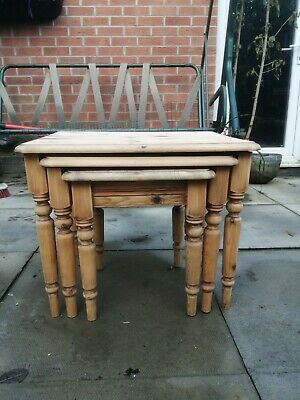 Three solid pine 1980's carved nest of tables