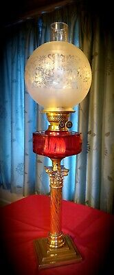 Late Victorian cranberry glass oil lamp and shade.