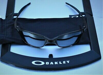 Oakley Juliet X-metal sunglasses in carbon, black polarized lenses.