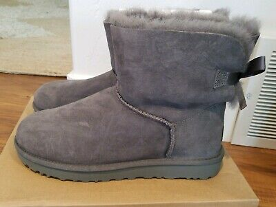 Details about UGG MINI BAILEY SEQUIN BOW GOLD SUEDE SHEEPSKIN BOOTS SIZE US 11 WOMENS