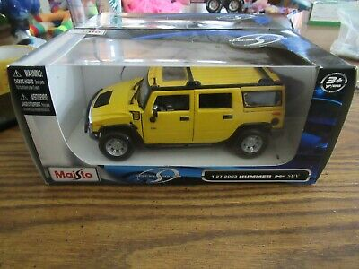 Maisto 2003 yellow Hummer H2 SUV NEW IN BOX 1:27