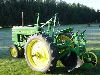 John Deere H Tractor With H10, H4, H3 And H1 Rare Moldboard Plows