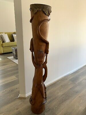 Authentic traditional carved wooden drum from PNG.