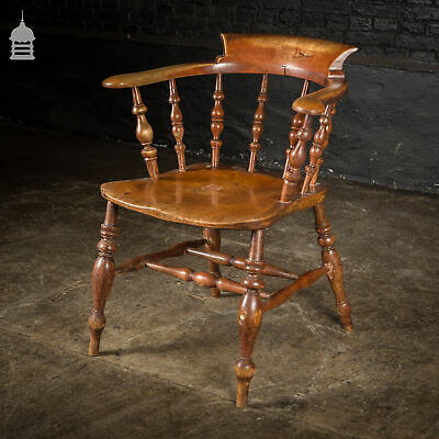 19th C Elm Captains Bow Seat Smokers Chair with Turned Arm Support and Double H