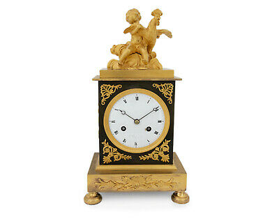 French Empire ormolu clock, pendulette, putto with rooster signed Rt Cary