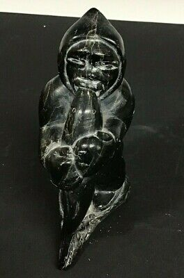 Black Inuit Carving Of An Eskimo With Fish