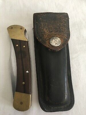Vintage buck 110 folding knife with original pouch