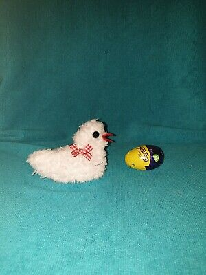 Hand knitted Easter chick egg cosy to cover a creme egg. Red check bow