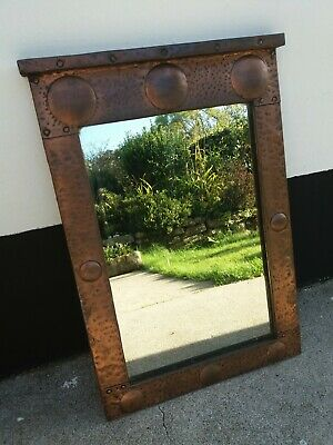 Arts & Crafts copper framed Liberty style mirror C1900/1910