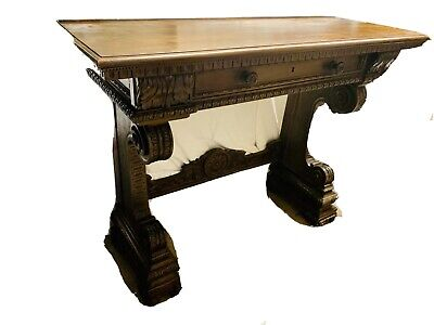 A substantial Victorian carved oak serving table With Middle Drawer.