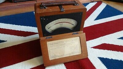 Vintage wooden cased voltmeter. Shame to make a nixie clock or lamp out of it.
