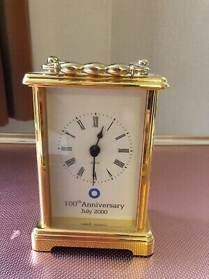 brass carriage clock- blue circle 100 year commeration good working order