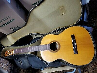 acoustic guitar  very old with case