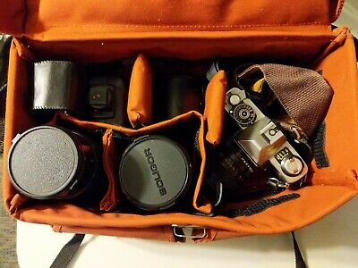 Minolta SLR film camera with lens, bag, accessories, Metal body, lenses