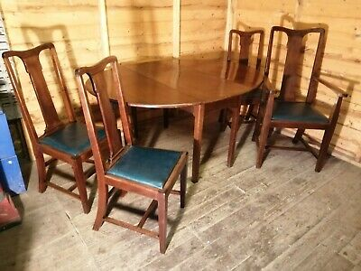 Large oval mahogany drop leaf dining table with 4 dining chairs
