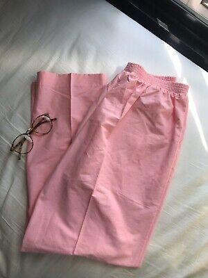 Groovy vintage pastel pink high waisted pants.