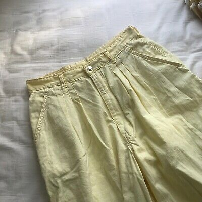 Amazing vintage high waisted cropped pale yellow pants.