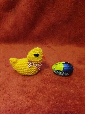 Hand knitted Easter chick egg cosy to cover a creme egg. Red gingham bow