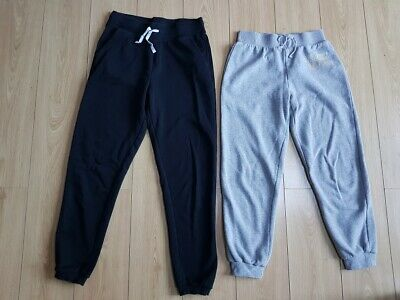 2 x girls track suit bottoms – black & grey age 11