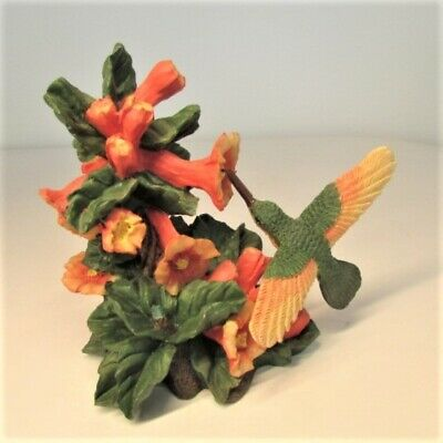 """Movable Hummingbird with Orange Orchid Flowers Figurine 4.5"""" x 4"""""""
