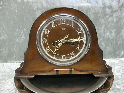 Vintage 1950s Smiths Enfield striking mantle clock with brass key.