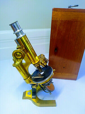 Antique Reichert brass microscope of late 1800s in wooden box with lenses