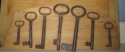 Rare Antique Collection Of 7 Primitive Skelton Keys Mounted On Board