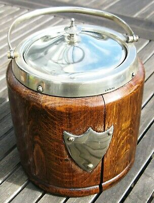 An English Oak, ceramic lined, EPNS Biscuit Barrel or Ice Bucket from 1915 - 25