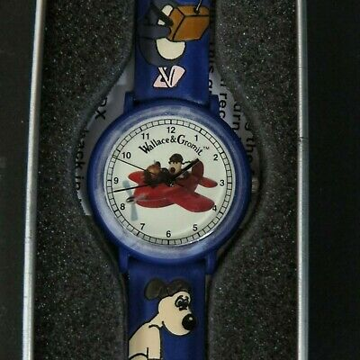Gromit in Plane: Wallace and Gromit watercolor tin, Porthole quartz analog Watch