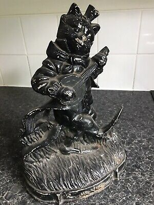 antique cast iron doorstop
