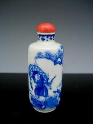 An Antique Chinese Blue And White Porcelain Snuff Bottle And Coral Stopper